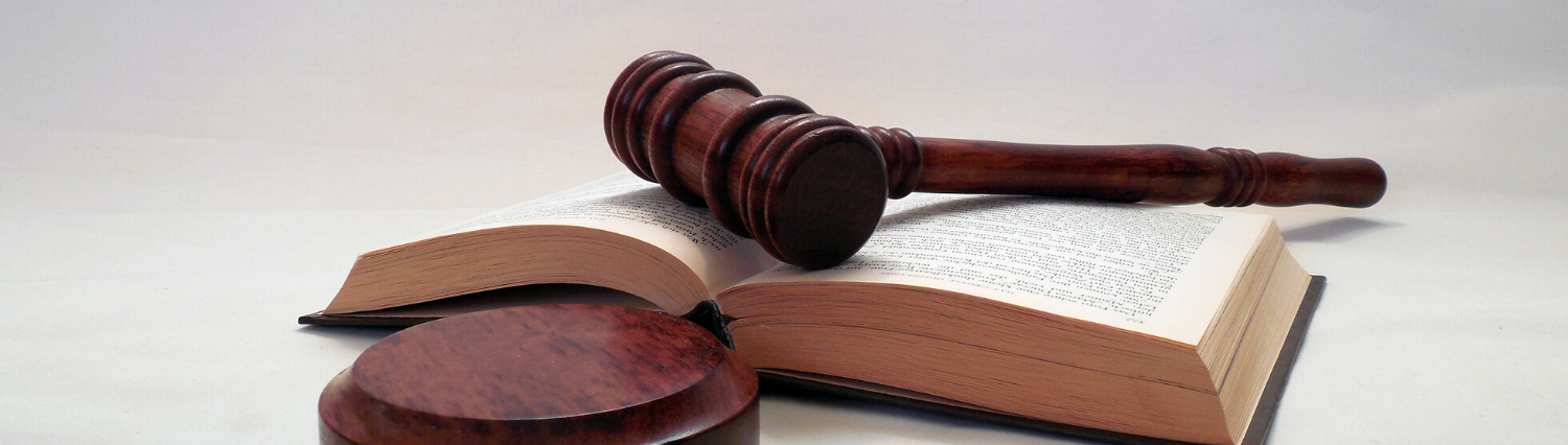 Compliance and By-Laws banner image of book and gavel
